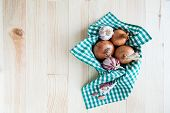 Composition Of Onions And Garlic In Basket On Wooden Table