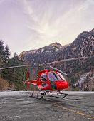 Red Helicopter In Heliport At Swiss Alps 2