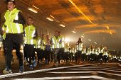 Runners In Reflective Clothes