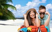 Happy couple packs up suitcase with clothing for trip, tropical island background. Concept of romantic vacations and lovely honeymoon
