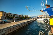 GALAXIDI, GREECE - SEP 29, 2014: Mooring. Unidentified sailors participate in sailing regatta