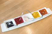 picture of condiment  - Condiments set on a wooden table in restaurants - JPG