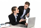 Young Attractive Businesswoman Working At Computer Laptop In Office Arguing With Work Colleague In S