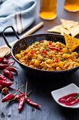 foto of curry chicken  - indian chicken curry with peas and chili pepper on pan - JPG