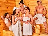 image of sauna woman  - Group people in  hat  relaxing at sauna - JPG