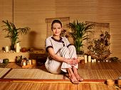 pic of deportation  - Bamboo massage at spa and woman - JPG