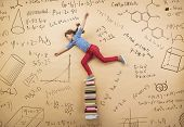 stock photo of frot  - Cute little girl learning playfully in frot of a big blackboard - JPG
