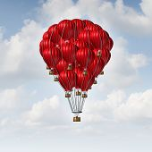 foto of collaboration  - Group concept as a team of red hot air balloons joined together as a symbol for teamwork unity and collaboration solidarity with people being lead by an individual manager - JPG
