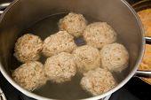 foto of boil  - Dumplings in a boiling pot - JPG