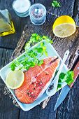 picture of redfish  - raw salmon with spice and lemon on the wooden board - JPG
