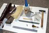 foto of leather tool  - Tools materials and pattern for making leather case for mobile phone - JPG