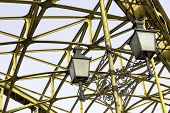 picture of spreader  - Decorative lamps hanging from old bridge - JPG