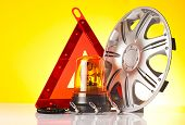picture of rectifier  - group of car accessories on yellow background - JPG