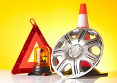 foto of rectifier  - road emergency items and car accessories on yellow background - JPG