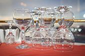 pic of inverted  - inverted wine glasses on a red tablecloth - JPG