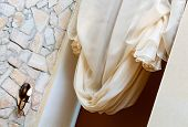 foto of art nouveau  - Art nouveau style curtain in window frame - JPG