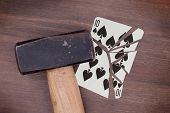 picture of spade  - Hammer with a broken card vintage look ten of spades - JPG