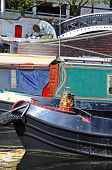 stock photo of west midlands  - Narrowboat in Gas Street Canal Basin with a pretty painted tin bucket Birmingham West Midlands England UK Western Europe - JPG