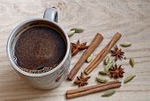 stock photo of cardamom  - coffee star anise cinnamon stick and cardamom on a wooden background - JPG