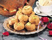 stock photo of laddu  - Baloo Shahi is a traditional indian sweet made with wheat flour and nuts - JPG