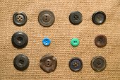 picture of hasp  - A lot of old buttons scattered on the old cloth - JPG