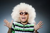 stock photo of afro  - Funny man with afro hairstyle isolated on white - JPG
