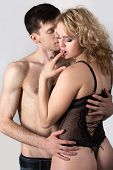 pic of caress  - Attractive sexy young couple hugging feeling pleasure handsome guy in jeans caressing with passion blond girl in black lace underwear - JPG