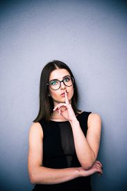 pic of shhh  - Portrait of a beautiful woman in glasses with finger over lips - JPG