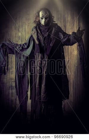 scary man in iron mask and black robe fantasy halloween poster
