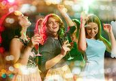 party, holidays, celebration, nightlife and people concept - smiling friends with glasses of champag poster