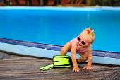 foto of flipper  - cute girl with flippers in swimming pool at tropical beach - JPG