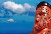 stock photo of maori  - Traditional maori carving and Taranaki Mount New Zealand - JPG