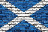 Постер, плакат: Grunge Flag Of Scotland On A Brick Wall