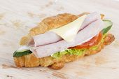 Постер, плакат: Croissant Sandwich With Ham Cheese