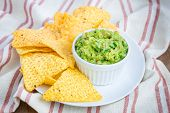 image of nachos  - Cup with chunky guacamole served with nachos - JPG