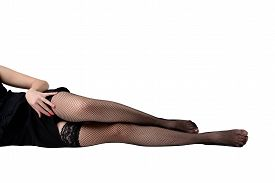 stock photo of stocking-foot  - Photo of a slim female legs in stockings - JPG