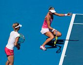 MELBOURNE, AUSTRALIA -JANUARY 28: Victoria Azarenka of Belarus (R) with partner Maria Kirilenko of R