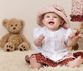 foto of newborn baby girl  - little child baby smiling playing in the room - JPG