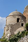 Traditional fortified village of Monemvasia and a Byzantine church at Greece.