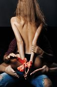 Bare Female Body With Red Bow poster