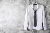 White Shirt With Long Sleeves And Necktie On Grunge Background. Free Space For Text poster