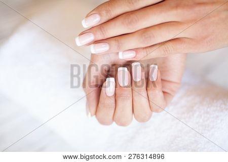 poster of Woman Hand Care. Closeup Of Beautiful Female Hands Having Spa Manicure At Beauty Salon. Beautician F