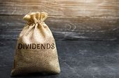 Money Bag With The Word Dividends. A Dividend Is A Payment Made By A Corporation To Its Shareholders poster