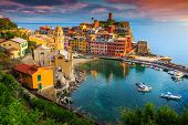 Fantastic Panorama Of Vernazza, Amazing Colorful Medieval Buildings And Fishing Boats In Harbor At S poster