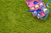 Colored Easter Eggs And Spoons In A Egg-box
