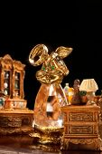 Two wedding rings on jewelry rabbit in antiquarian living room with period furniture
