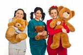 Cheerful Women In Pyjamas With Teddy Bears