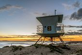 Life Guard Tower Makes Perfect Spot To Hangout While Watching The Sun Set Over The Pacific Ocean Hor poster