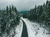 Freedom Concept Aerial View Of Suv At Snowed Highway. Road Trip. Car Travel. Beautiful Mountains poster