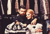 Woman With Smiling Face In Black Fur Coat With Bearded Man. Luxury Shopping Concept. Couple In Love  poster